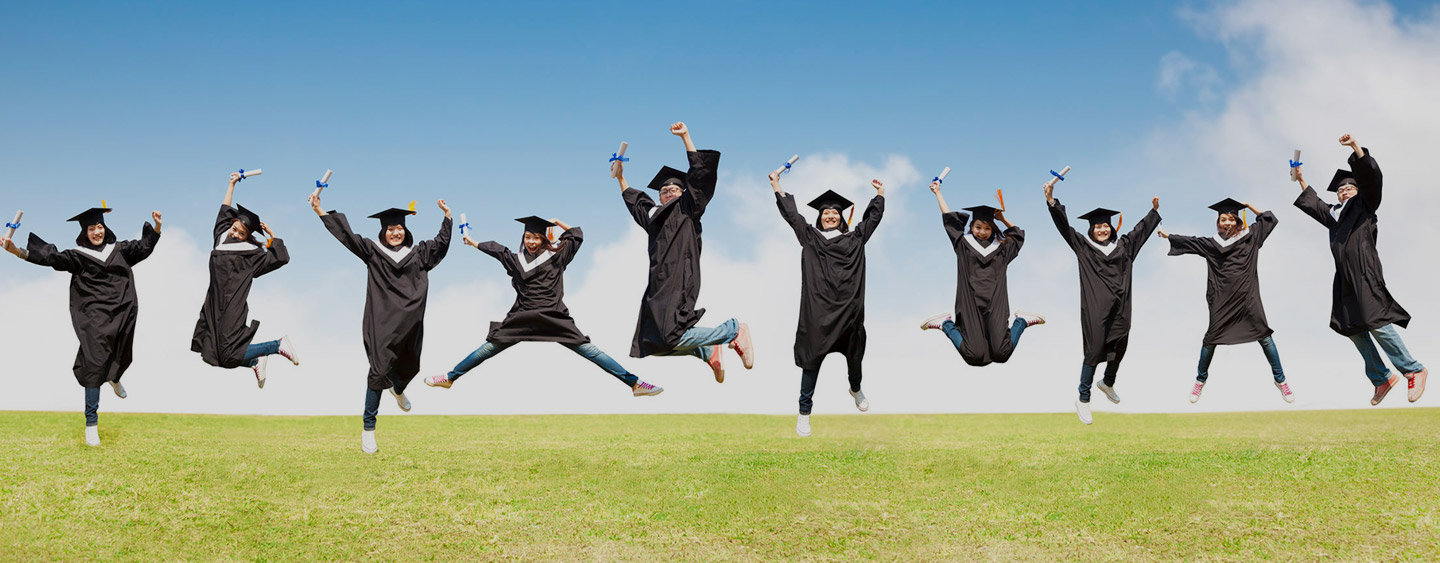 Graduates jumping with diplomas – school placement services